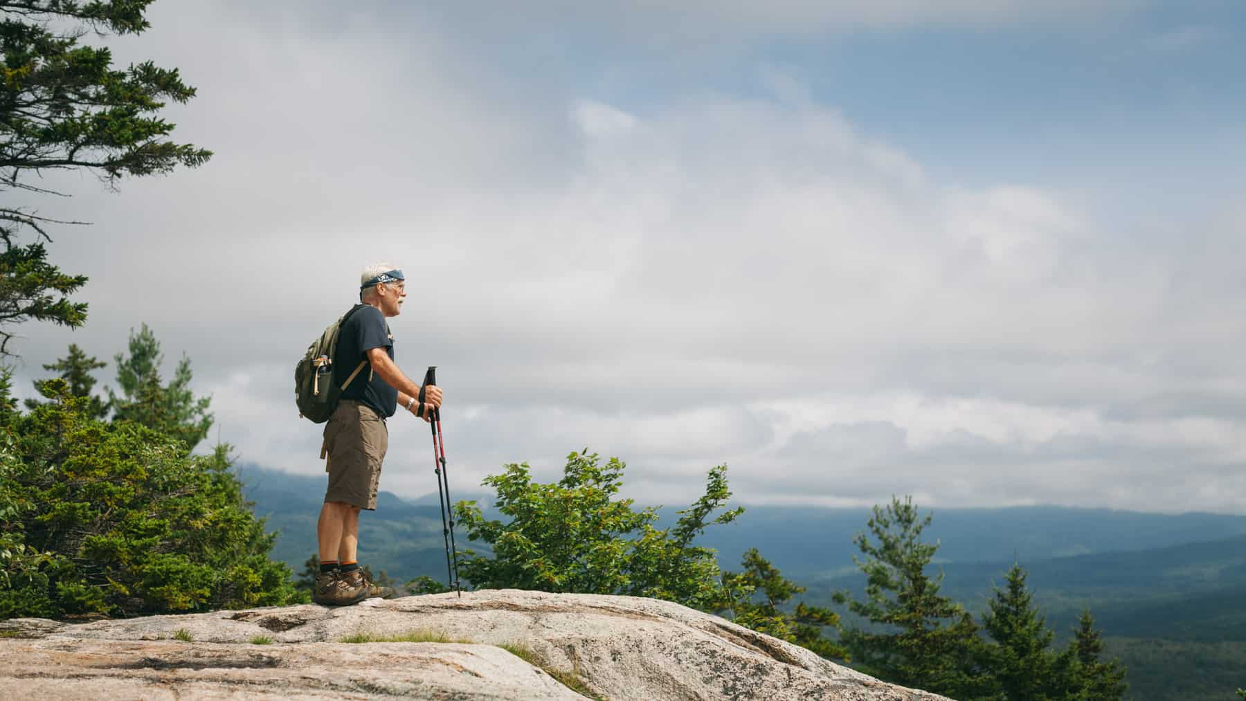 A Hiker looks out from the summit of Hedgehog Mountain